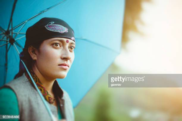 young woman in nature with umbrella. - bindi stock pictures, royalty-free photos & images