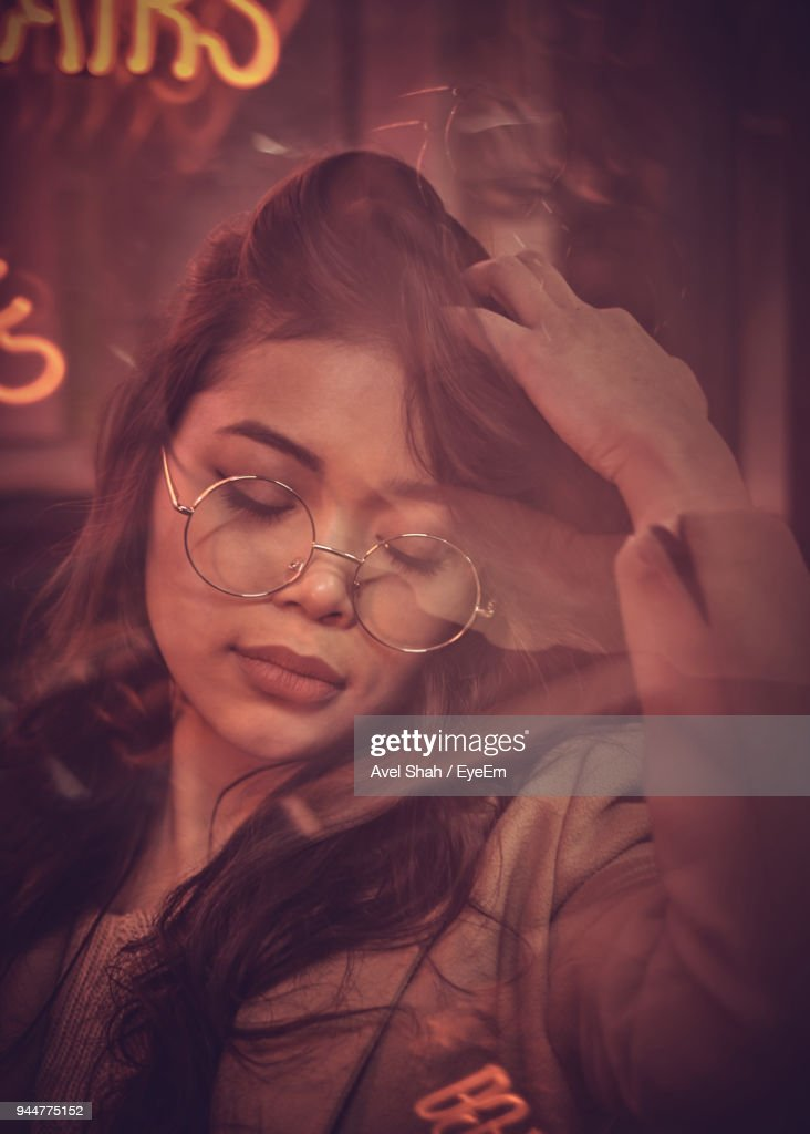 Young Woman In Nightclub Seen Through Glass : Stock Photo