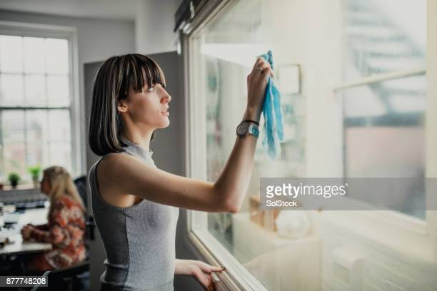 Young Woman in Office Cleaning