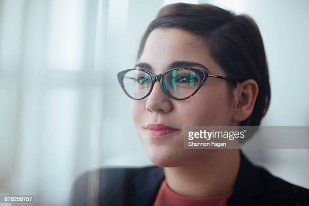 Young woman in office looking ahead