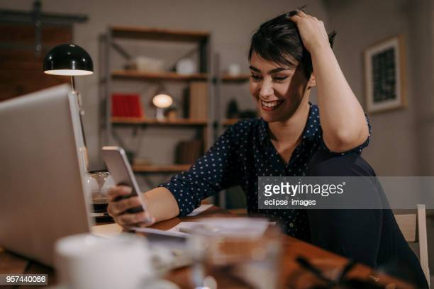 young woman in online world - phone message stock pictures, royalty-free photos & images