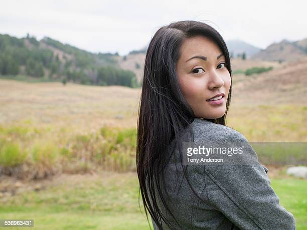 Young woman in outdoor mountain landscape