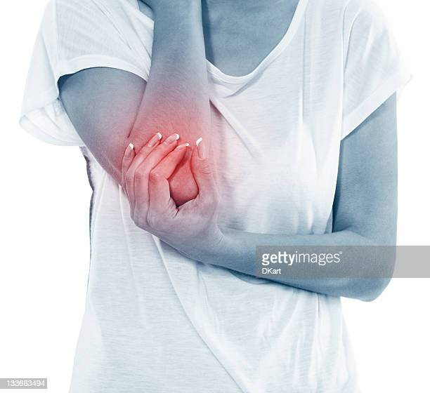 Young woman in pain with an elbow injury