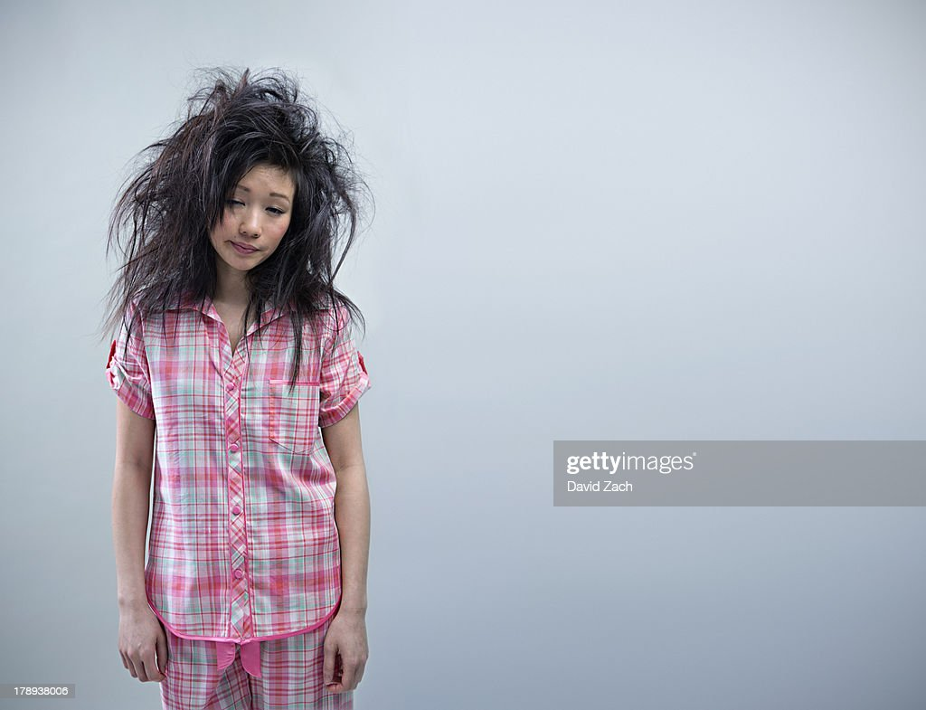 06fad72ac7 Young Woman In Pajamas And Messy Hair Portrait Stock Photo