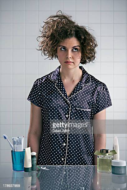 Young woman in pajamas in bathroom