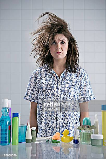 young woman in pajamas with messy hair - bad hair stock pictures, royalty-free photos & images