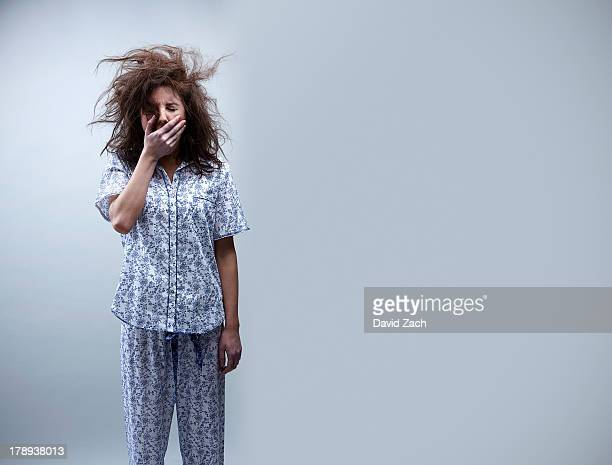 young woman in pajamas, yawning - yawning stock pictures, royalty-free photos & images
