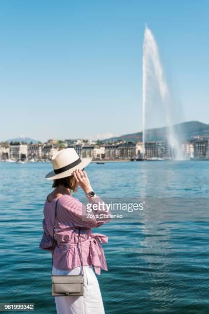 Young woman in panama hat on Geneva lake