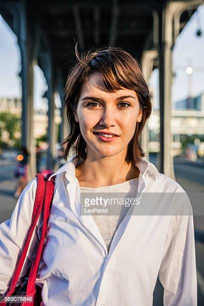 young woman in paris, smiling, having fun in the city - ile de france stock pictures, royalty-free photos & images