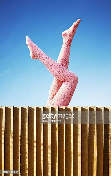 young woman in pink tights with legs in the air. - appearance stock pictures, royalty-free photos & images