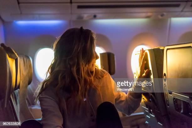 Young woman in plane at sunrise
