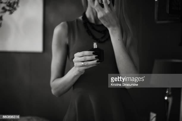 young woman in pretty dress holding a bottle of perfume - marriage stock pictures, royalty-free photos & images