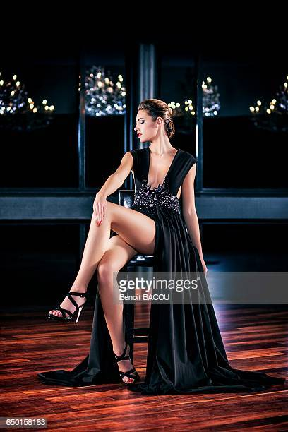 Young woman in profile evening dress, sitting, gaze on the side