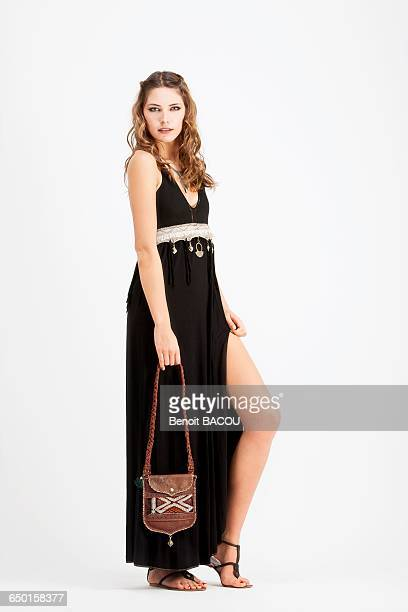 young woman in profile, wearing a handbag and a black dress sanhadja - leather dress stock pictures, royalty-free photos & images