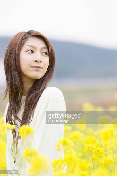 Young woman in rape field