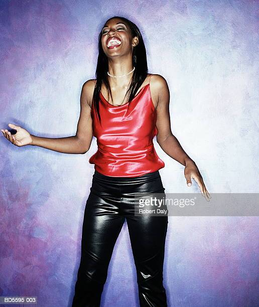 young woman in red top, laughing, portrait - clubkleding stockfoto's en -beelden