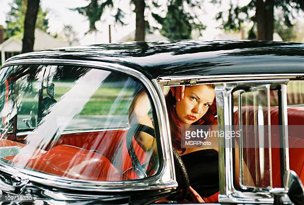 Young Woman in Retro Car