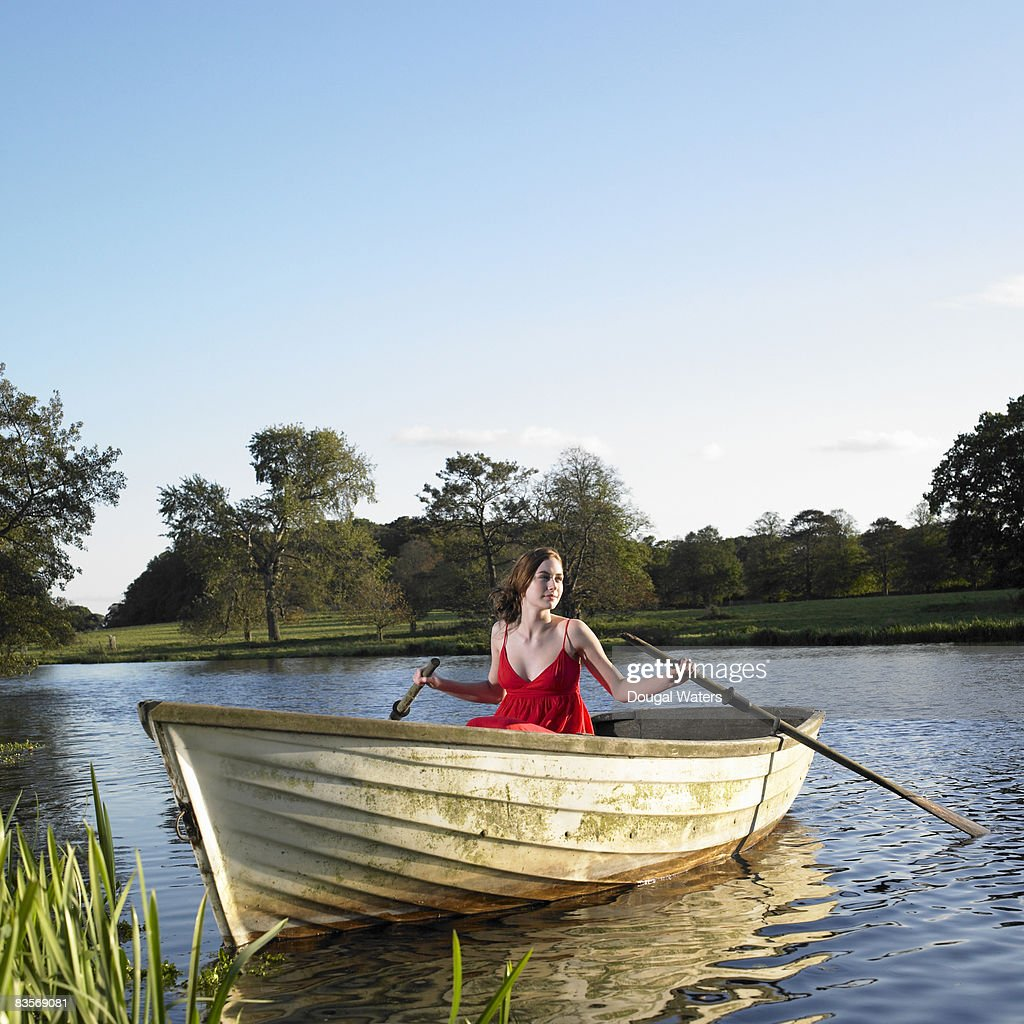 Young woman in rowing boat. : Stock Photo
