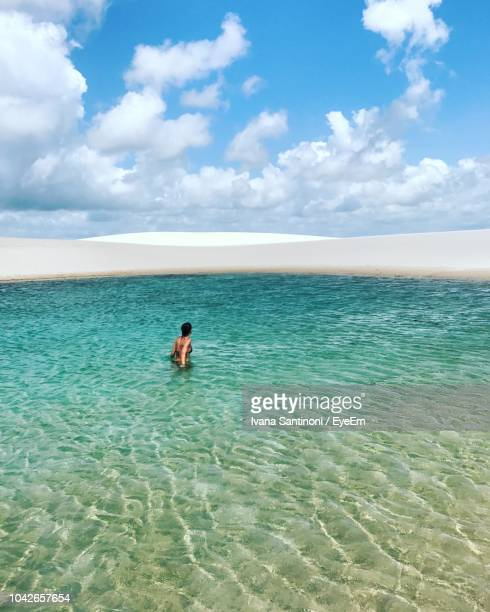 young woman in sea against sky - barreirinhas stock pictures, royalty-free photos & images