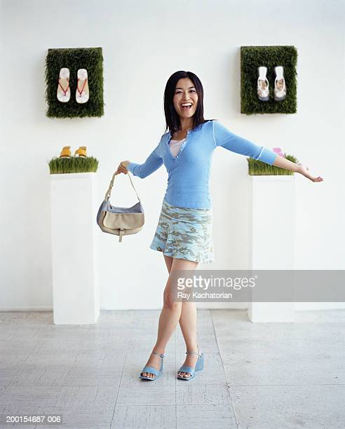 young woman in shoe store - japanese short skirts stock pictures, royalty-free photos & images