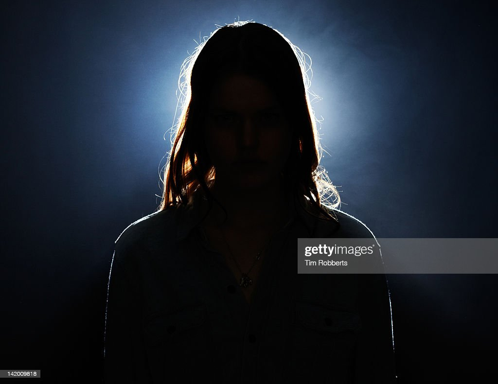 Young woman in silhouette. : Stock-Foto