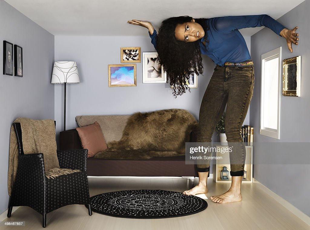 young woman in small scale living room : Stock Photo