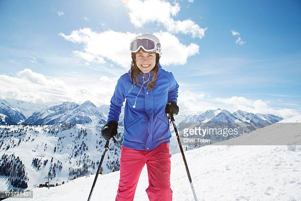 young woman in snow with ski gear - skifahren stock-fotos und bilder