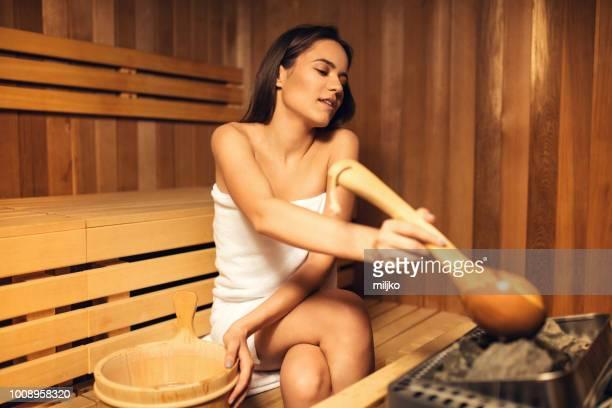 junge frau in spa-center - sauna stock-fotos und bilder