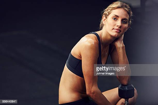 Young woman in sport clothes looking at camera