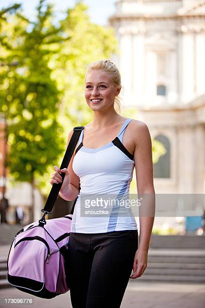 Young Woman in sport wear walking on London streets
