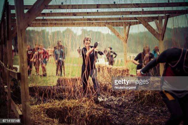 young woman in sports competition - obstacle course stock photos and pictures