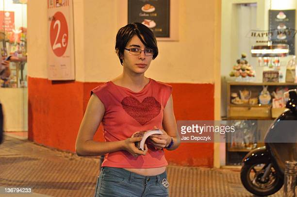 young woman in street handing out flyers - depczyk stock pictures, royalty-free photos & images