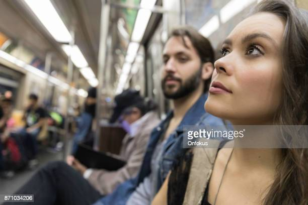 Young Woman in Subway Train, New York City