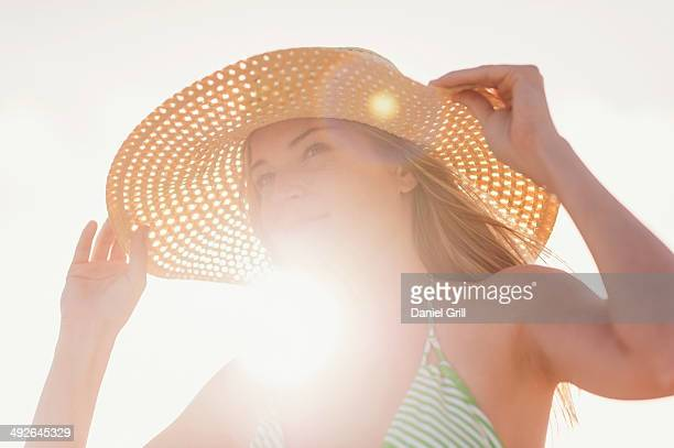 Young woman in sun hat on beach, Jupiter, Florida, USA