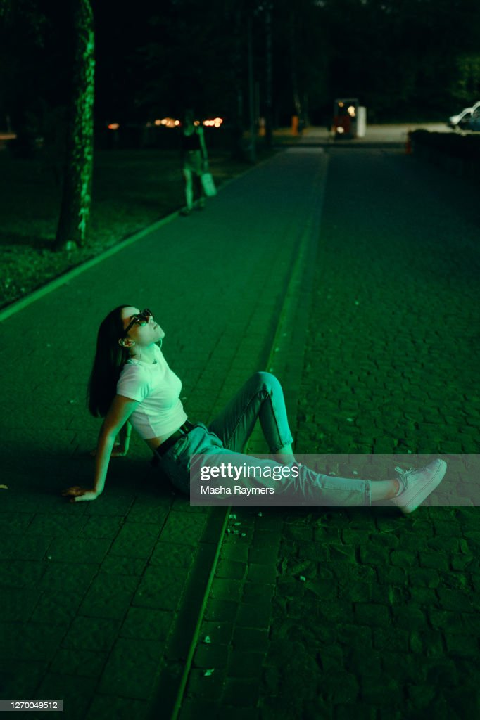 Young woman in sunglasses in neon lighting : Stock Photo