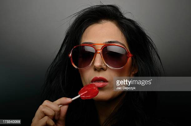 young woman in sunglasses with lollipop - depczyk stock pictures, royalty-free photos & images