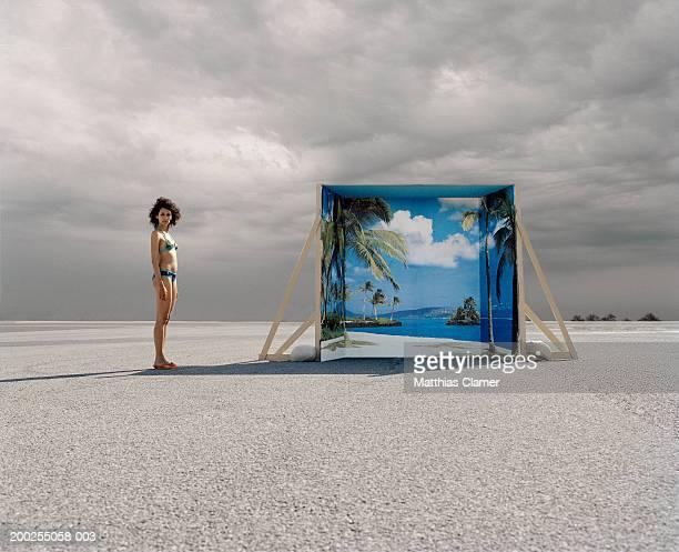 young woman in swimsuit standing near backdrop, portrait - tranquil scene foto e immagini stock