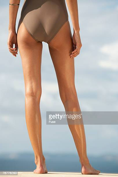 Young Woman in Swimsuit Standing Outdoors