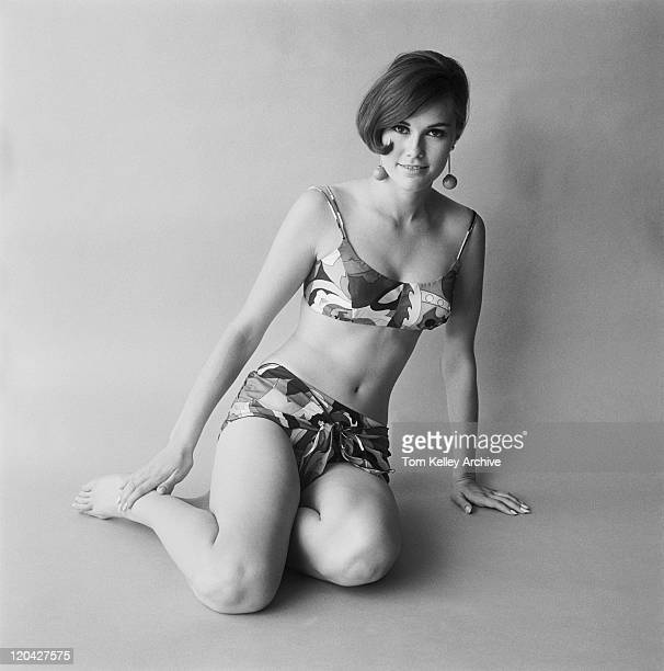 Young woman in swimwear on white background, portrait