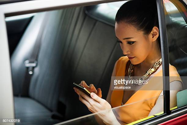 young woman in taxi - wealth stock pictures, royalty-free photos & images