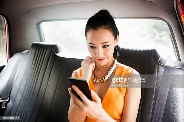 Young Woman in Taxi