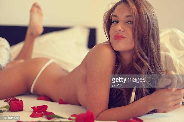 young woman in the bed - naket bildbanksfoton och bilder