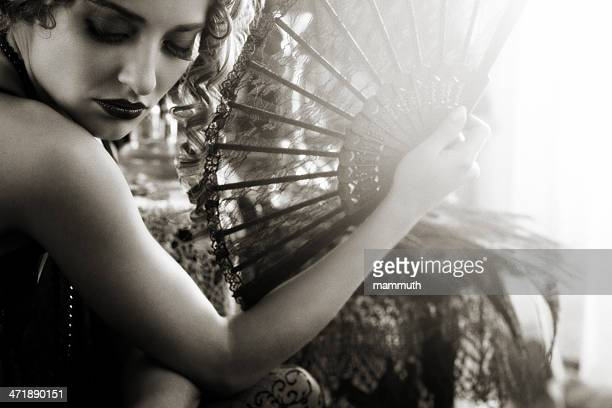young woman in the boudoir with lace fan
