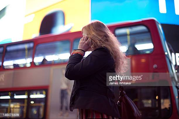 Young Woman in the Centre of London at Night