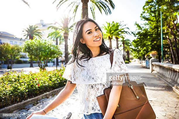 young woman in the city street during a beautiful day - beautiful filipino women stock photos and pictures