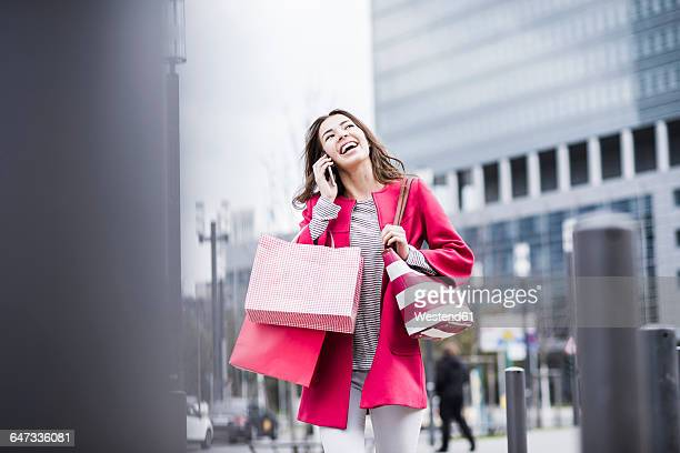 Young woman in the city using mobile phone
