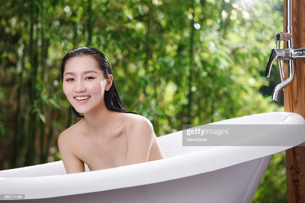 A Young Woman In The Outdoor Bathing High-Res Stock Photo