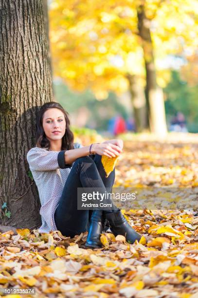 Young woman in the public park on a sunny autumn day