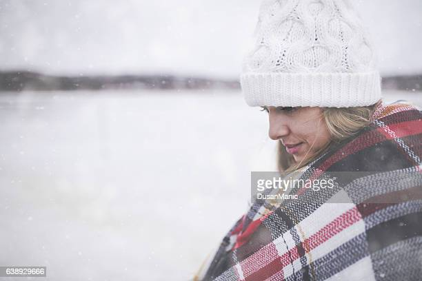 young woman in the snow wearing a checkered blanket - beautiful czech women stock photos and pictures