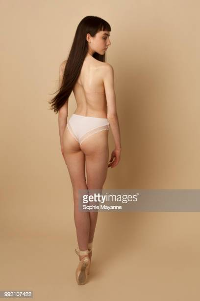 a young woman in the studio - scoliosis stock photos and pictures